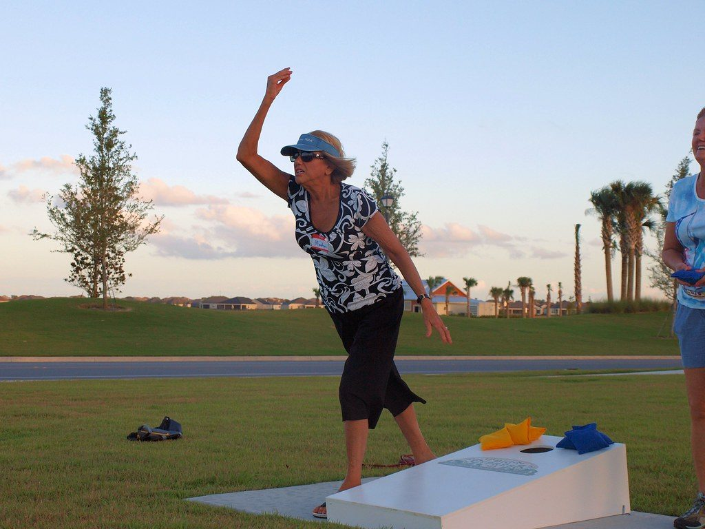 Woman playing cornhole