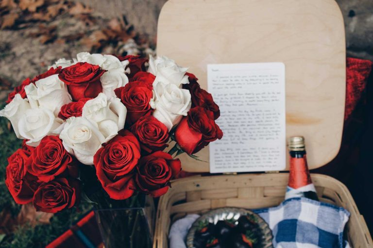 roses and love letter in a basket