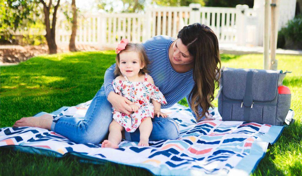 outdoor baby blanket mom and little girl