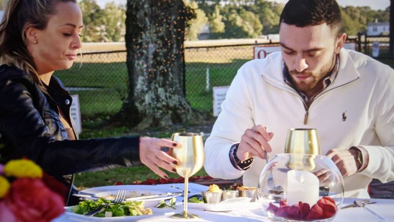 gold wine glasses on picnic table
