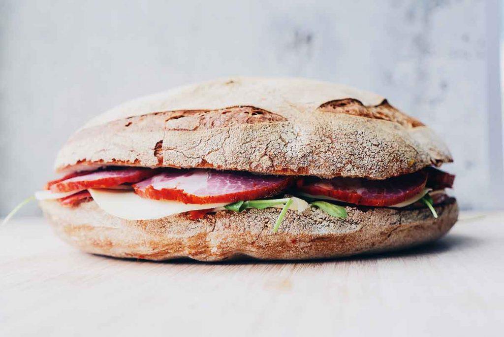 whole grain crusty bread sandwich with meat