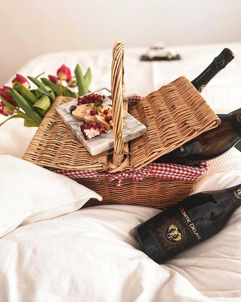 french wine bottles in a wicker basket