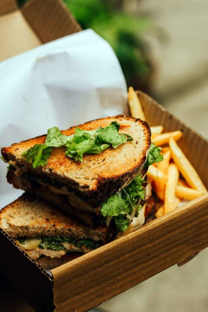 toasted bread sandwich with fries