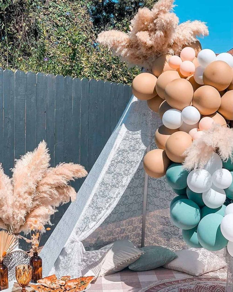 picnic tent decorated with balloons